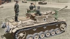A commanding officer salutes a parade of StuG 3 tanks belonging to the division 'Großdeutschland'