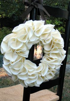 White felt wreath - felt circles, when attached, make wreath appear almost fluid.
