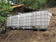 Rain Water Catchment: All 4 tanks in position, levelled, and connected via a 40mm pipe running along the bottom