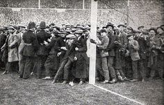 'There's some people on the pitch'... about 43 years too early. West Ham and Bolton fans are packed into a goalmouth at Wembley ahead of the 1923 FA Cup final