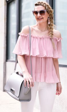 Braids and blush with a grey Zac Posen bag.