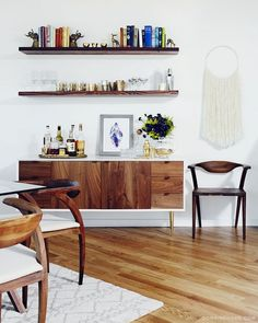 Exclusive: Tour Claire Thomas' Mod House on Stilts mid century modern styled bar area with open shelving