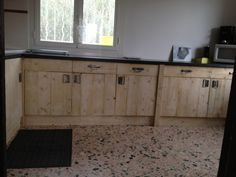 "rustic ""old world"" style kitchen cabinets made from pallets..."