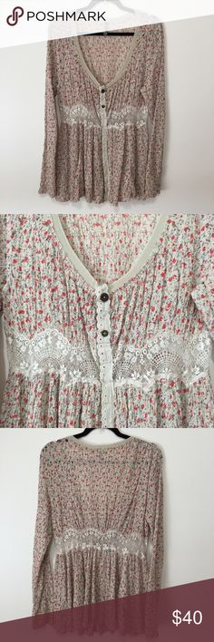 Free People Floral Print and Lace Dress Wide V neck at front with three accent buttons. Dress snaps all the way down with eyelet lace overlay detail. Lace at waist.  Long sleeve. Mini shirt. A beautiful dress to wear with knee high boots or layer over pants. Size L Free People Dresses Mini