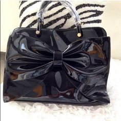 Black Patent Handbag w/Bow Small black patent handbag with large bow. Looks like the designer bag. Perfect for evening out. COS Bags