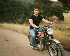 gerard butler.  A package deal. Man and bike