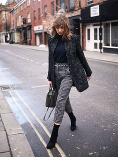 Manchester style: Lizzie Hadfield in blazer and check trousers
