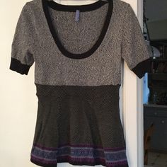 """NWOT Free People peplum sweater Beautiful soft knit, short sleeved peplum sweater with metallic thread trim. cotton/rayon. New without tags. Underarm across 14"""". Length 26"""". Bundle for even bigger savings! Offers welcome. No trades. Free People Sweaters Crew & Scoop Necks"""