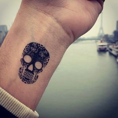 Small Skull Wrist Tattoo | Tatspiration.com - Your home for discovering tattoo ideas and tattoo inspiration.