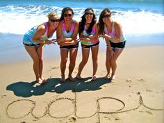 adpi sisters expressing their pride on the beach! | sorority sugar