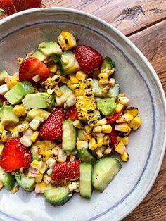 A refreshing summer strawberry salad that brings together all the summer's best - strawberries, cucumber, corn with nutritious avocado. #salad #summersalad #strawberrysalad #farmtotable #vegansalad #glutenfree #glutenfreesalad