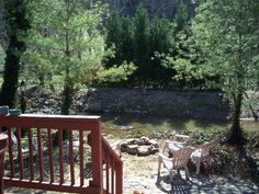 Out the back door you have access to a stream and a fire pit and comfortable lawn chairs.
