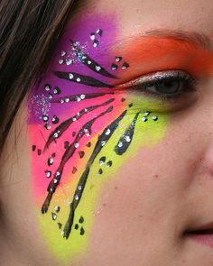 neon facepainting... girls, but more feather-like?