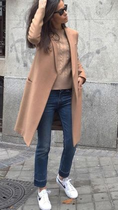 Casual yet stylish outfit.the camel coat and the sneakers are perfect