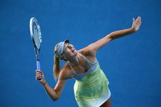 Maria Sharapova of Russia serves in her second round match against Misaki Doi of Japan during day three of the 2013 Australian Open at Melbourne Park on January 16, 2013 in Melbourne, Australia.