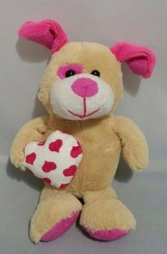 """Tan 9"""" Goffa Plush Dog. When he's singing his snout lights up. Press his tummy and he sings """"I'm Too Sexy"""". 