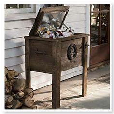 "Sweet Country Life ~ Simple Pleasures ~ Wooden Rustic Cooler Treat your guests to ice-cold drinks served from this stylish cedar cooler, trimmed with iron stars and mountains. Has galvanized steel liner, foam insulation, drainage spout and cast iron bottle opener. Easy to assemble. Small cooler holds 64 cans plus ice (27"" l x 18 3/4"" w x 31 1/4"" h. Large cooler holds 96 cans plus ice (47 1/4"" l x 15""w x 31 1/4"" h). www.countrydoor.com"