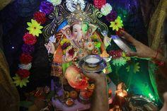 ffers kheer, an Indian sweet, to an idol of elephant-headed Hindu god Ganesha at their house on the second day of Ganesha Chaturthi festival in Mumbai, India. (Photo by Rafiq Maqbool/AP Photo)
