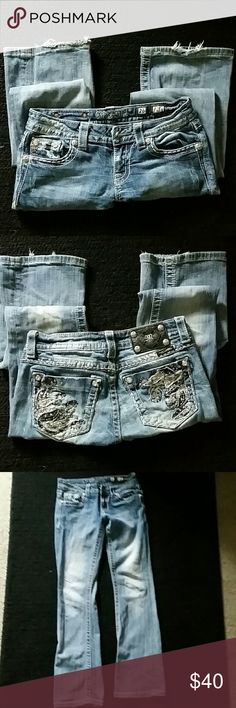 Miss me Very cute good condition miss me jeans 26/33 boot cut with thick navy blue and white stitching with silver sequence and studded a few studs missing but not noticeable. Also factory faded front and back a little fraying on bottoms Miss Me Jeans Boot Cut