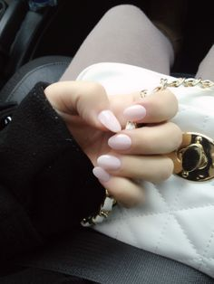 Oval nails make fingers look more graceful and pale colors don't compete with a beautiful ring.