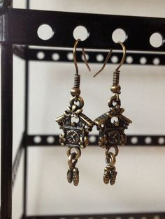 Cuckoo clock earrings. $5