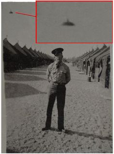 WWII UFO?  My family and I found some old WWII pictures in the trash and this photo really amazed us. It shows what looks like a UFO above the man getting his picture taken. I don't think he knew it was there!  --Ivan L.