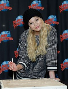 Olivia Holt visits Planet Hollywood Times Square in Times Square on March 8, 2015 in New York