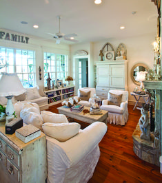 Loving this living room!  (My house wouldn't last long with white furniture though!)