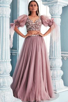 Featuring a lilac blouse in velvet and shantoon base with sweetheart neckline and organza puff sleeves. It is paired with a matching lehenga skirt in organza base. Party Wear Indian Dresses, Designer Party Wear Dresses, Indian Bridal Outfits, Indian Gowns Dresses, Indian Fashion Dresses, Dress Indian Style, Indian Designer Outfits, Party Wear Lehenga, Latest Wedding Dresses Indian