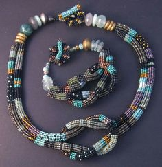 Necklace and bracelet by Julie Powell Seed Bead Jewelry, Jewelry Art, Beaded Jewelry, Beaded Necklace, Beaded Bracelets, Textile Jewelry, Fabric Jewelry, Julie Powell, Bead Crochet
