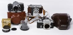 Lot 583: Camera Assortment; Including a Nikkor CP-2 lens, a Nikkor F lens hood, a Nikon camera #6816344, a Kodak Retina camera and an Exakta VXIIa Jhagee camera with a Tiffen lens