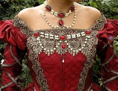 Interesting beadwork and design on this modern made Victorian dress.