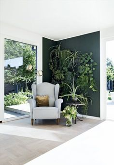 Coloured walls at home - paintind ideas for interior | Plant wall with dark green interior #greenwall