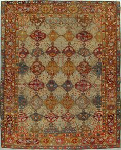 Antique Oushak Rug -  Circa:	1900 Sizes:	9.8X12.4 This design is adapted from classical 16th century Persian carpets