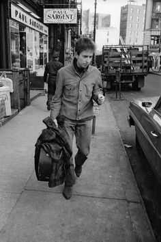 Bob Dylan getting a taxi on Fourth Street in Greenwich Village, 1964. Photo by Ted Russell.