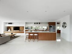 Open Plan Living  - Aria Bulkhead coming around the kitchen and living cabinetry