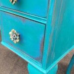 Painted wih a base of Greek Blue Chalk Paint®, then Florence over that, distressed very heavy and a glaze of Artisan Enhancements Pearl Plaster. From the Hoity-Toity Peacock