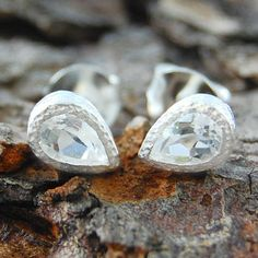 White Topaz Silver Tear Drop Stud Earrings - A stunningly elegant pair of silver stud earrings featuring a single semi precious tear drop white topaz stone in a naturally textured sterling silver setting. #Embersjewellery #Jewellery #MotherDay #Present