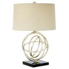This lamp is a contemporary take on an armillary, which is a spherical framework of rings, depicting a celestial body. It is finished in silver leaf with an off white shantung shade.