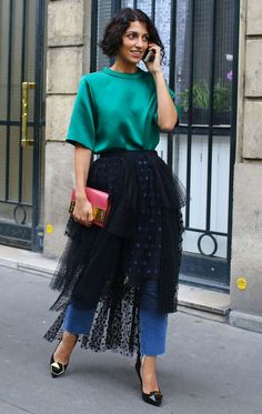 Yasmin Sewell in a green top, tulle skirt, and jeans