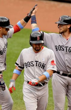BALTIMORE, MD - JUNE 16: Will Middlebrooks #16 of the Boston Red Sox (L) celebrates hitting a three run home run with Shane Victorino #18 (C) and Jared Saltamacchia (R) during the seventh inning of a a baseball game against the Baltimore Orioles on June 16, 2013 at Oriole Park at Camden Yards in Baltimore, Maryland. (Photo by Mitchell Layton/Getty Images)