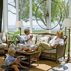 10 Beautiful Beach Cottages | Relaxing Wicker Porch | CoastalLiving.com