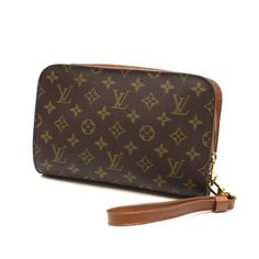 Louis Vuitton Orsay Monogram Second Canvas Brown Wristlet. Get the trendiest Clutch of the season! The Louis Vuitton Orsay Monogram Second Canvas Brown Wristlet is a top 10 member favorite on Tradesy. Save on yours before they are sold out!