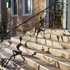Hand forged wrought Iron outdoor Railing. Note the detail on the silhouettes.