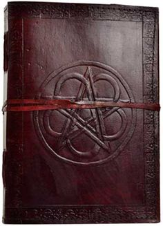 "Hand tooled lined leather journal with embossed interwoven pentagram & flower. Border embossing may vary. Size may vary slightly. Leather, handmade paper. 250 pages, cord closure. 7"" x 10"""