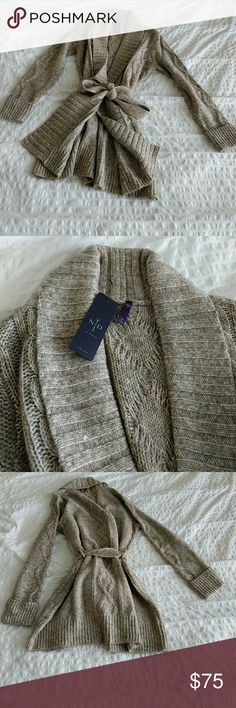 """NYDJ sz Medium NWT Cable Knit Cardigan,Taupe A shawl collar and cable patterning lend heritage appeal to a marled cotton-blend cardigan in a long, easy cut. A tie belt keeps the silhouette in check. - 32 1/2"""" regular length (size Medium); 30 1/2"""" petite length (size Medium P) - Open shawl collar - Long cuffed sleeves - Removable tie belt - 73% cotton, 20% acrylic, 7% wool - Dry clean or hand wash cold, dry flat NYDJ Sweaters Cardigans"""