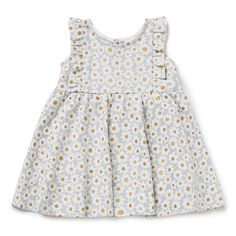 100% Cotton. Frill sleeve dress features all-over glitter daisy yardage print. Regular fitting silhouette. Available in Cloud.