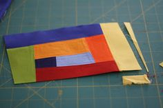 I've been having so much fun making improv blocks that I thought I'd share with you a tutorial on the process I use. I'll show you how I take the traditional log cabin block and m…
