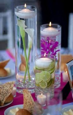 Cylinder vases with floating candles and submerged flowers. I just think submerged flowers are so pretty. The link's a little funny--it gives you the option on what site to go to--but all you really need is the picture. Purple Wedding Centerpieces, Floating Candle Centerpieces, Wedding Decorations, Centerpiece Ideas, Summer Centerpieces, Hanging Candles, Candle Vases, Vase Ideas, Christmas Centerpieces