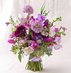 1. Lilac  2. Anemone  3. Star of Bethlehem  4. Hyacinth  5. Purple Allium  6. Green Mist  7. Mokara Orchid  8. Hellebore  9.  Sweet Pea  10. Silver Brunia  11. Kangaroo Paw  12. Tulip